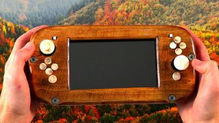 A wooden Nintendo Switch on a background of an autumnal forest.
