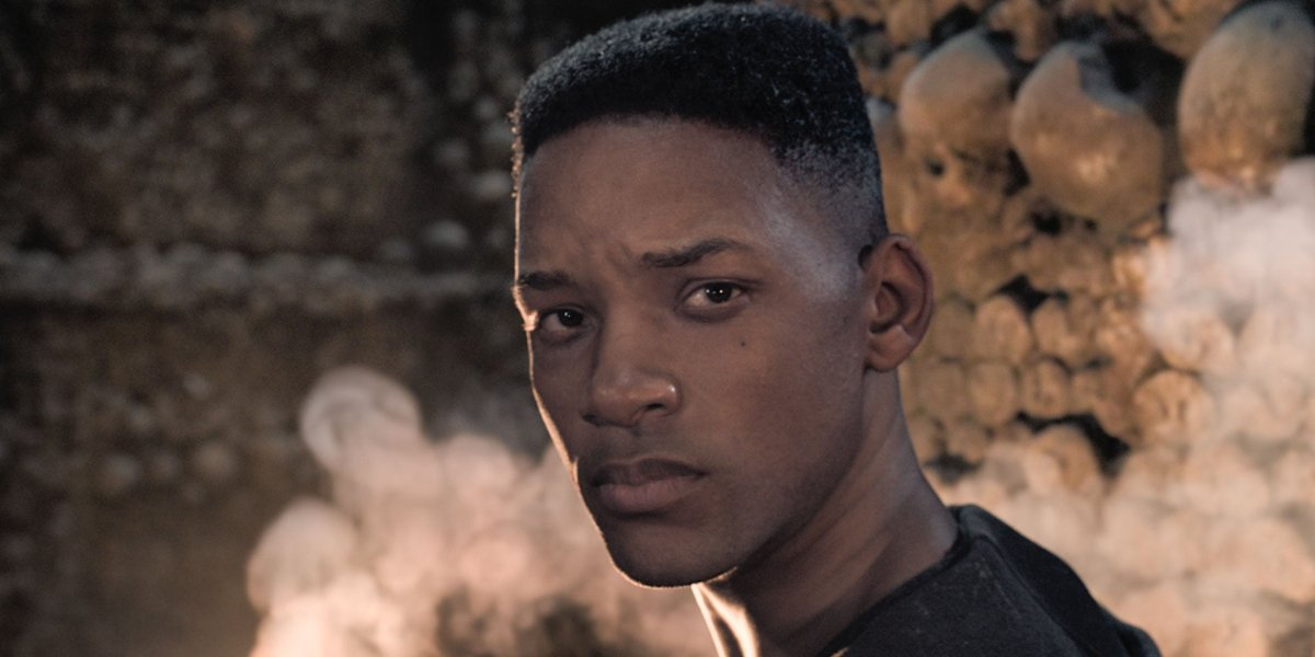 Gemini Man young Will Smith looks away from the fire in the catacombs