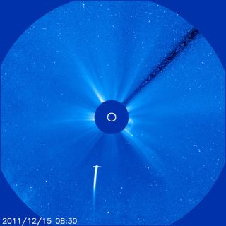 Comet Lovejoy is the bright streak at the bottom of this image, taken by SOHO's Large Angle Spectrometric Coronagraph (LASCO) C3 instrument. SOHO's LASCO instrument is a coronagraph. It blocks out the light from the Sun's disc, creating an artificial ecli