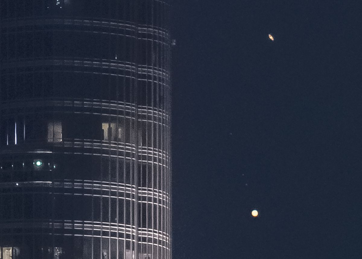 """Jupiter and Saturn descend on the tallest building in the world in the epic video """"Great Conjunction"""""""