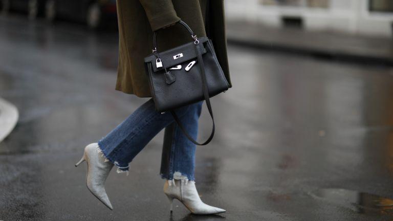 how to wear boots with jeans street style Lou Beyer wearing Balenciaga heels, Hermès bag, Agolde jeans, Zara blazer