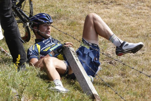 Johnny Hoogerland is caught in barbed wire after a crash during stage nine of the 2011 Tour de France