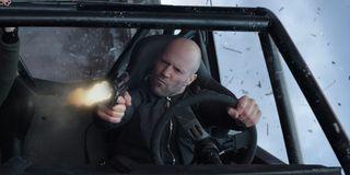 Jason Statham as Deckard Shaw firing his gun in Hobbs and Shaw