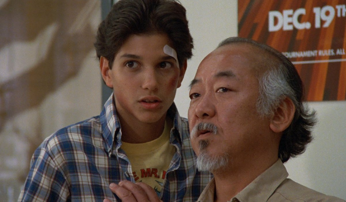 The Karate Kid Ralph Macchio and Pat Morita talking together