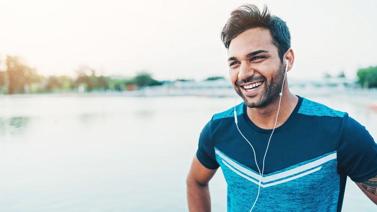 Man smiles as he exercises outside