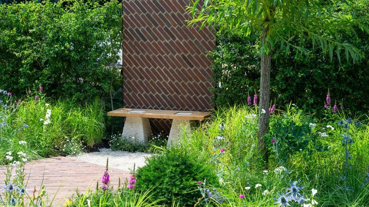 The South Oxfordshire Landscape Garden at RHS Hampton Court Palace Flower Show 2018 with brick terrace and wall inspired by Brunel railway bridge