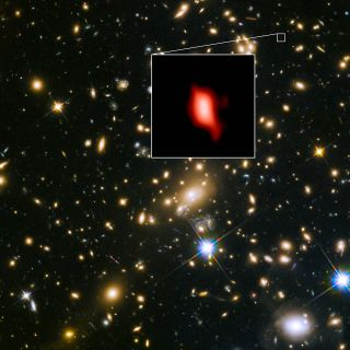 The distant galaxy MACS1149-JD1, shown in the insert, appears as it was 13.3 billion years ago, only 500 million years after the Big Bang. Oxygen distribution detected by ALMA appears in red.