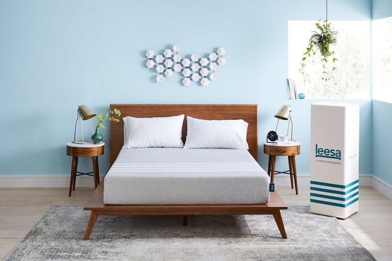 leesa mattress discount code: mattress on brown wooden bed in blue bedroom