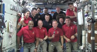 The STS-133 and Expedition 26 crew members gather in the Destiny laboratory of the International Space Station to speak with President Barack Obama on March 3, 2011.