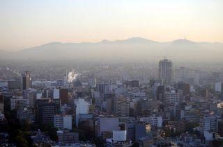 Hazy skyline of Mexico City at dawn.