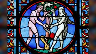 stained glass window of Adam and Eve