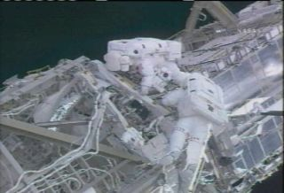 Astronauts Mark 100th Station Spacewalk