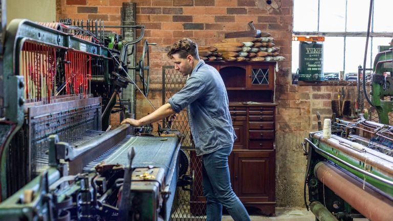 weaving fabric on a vintage loom