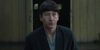 Barry Keoghan walking out of a shack in Marvel's Eternals.