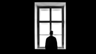 silhouette of man at window