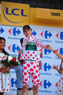 Pierre Rolland pulls on polka-dot jersey