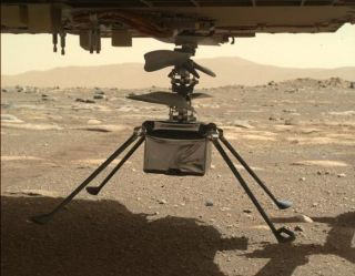 The Mars helicopter Ingenuity with all four legs unfolded, as seen by the Perseverance rover on March 30, 2021. After dropping to the Martian surface April 4, NASA is announcing new helicopter updates April 5.