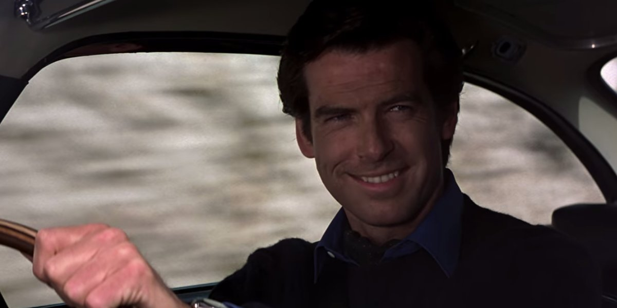 Goldeneye Pierce Brosnan smiling behind the wheel