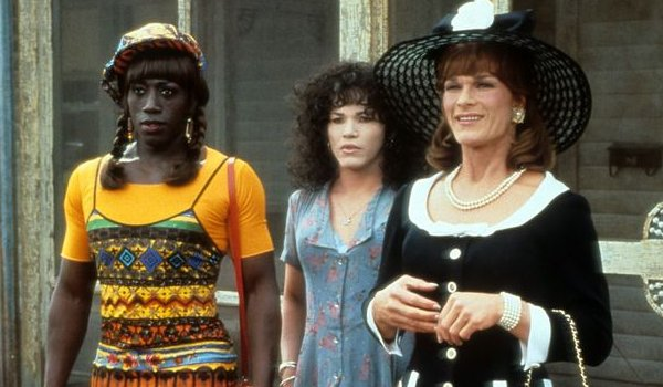 To Wong Foo Wesley Snipes John Leguizamo and Patrick Swayze stand on the front porch, in drag