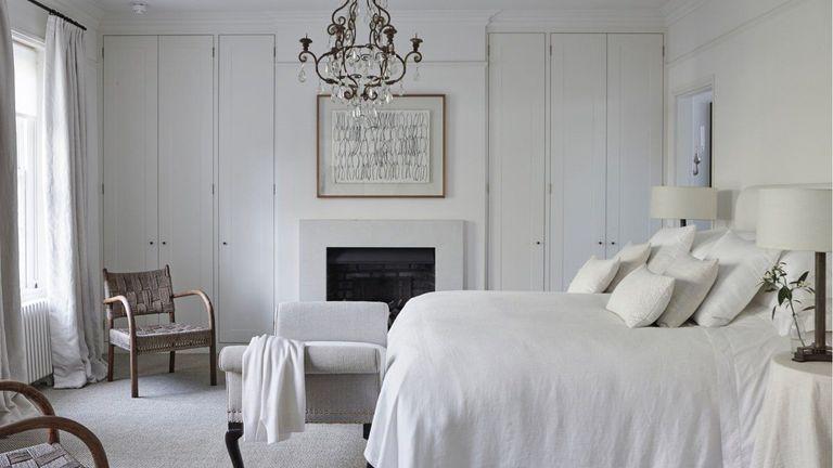 Romantic bedroom ideas – white bedroom with rustic chandelier
