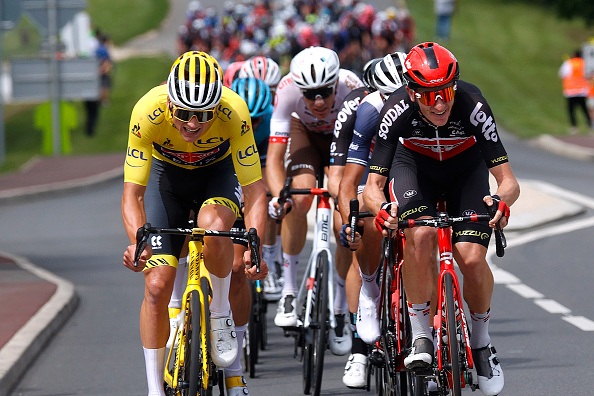 LE CREUSOT FRANCE JULY 02 Mathieu Van Der Poel of The Netherlands and Team AlpecinFenix yellow leader jersey Harry Sweeny of Australia and Team Lotto Soudal during the 108th Tour de France 2021 Stage 7 a 2491km km stage from Vierzon to Le Creusot 369m LeTour TDF2021 on July 02 2021 in Le Creusot France Photo by Chris GraythenGetty Images