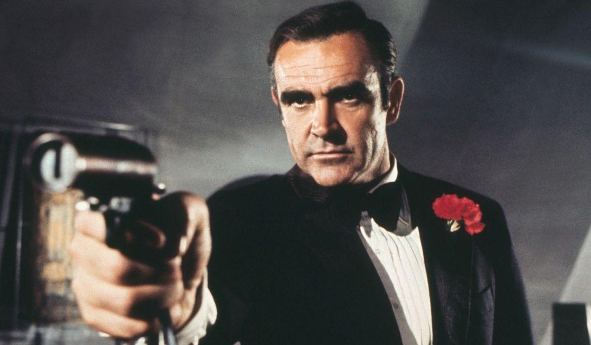 Sean Connery aiming his gun, in a tuxedo, in Diamonds Are Forever