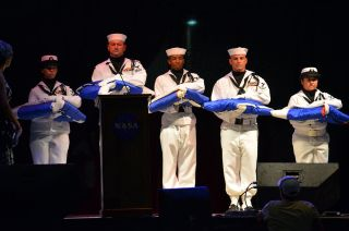 A Navy honor guard accepts the flags for all five of NASA's shuttles: Columbia, Challenger, Discovery, Atlantis and Endeavour at Johnson Space Center's shuttle program celebration on Aug. 27, 2011