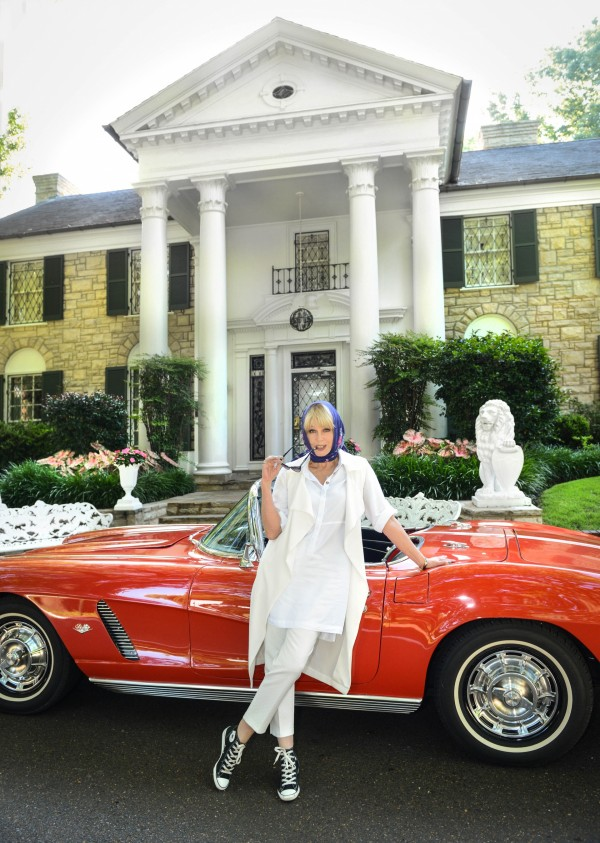 Joanna Lumley stands by a red Corvette at Gracelands Memphis Tennessee, Elvis's house