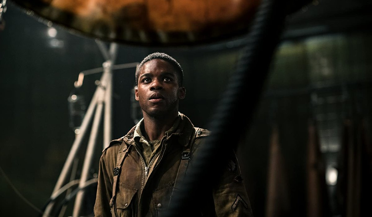 Overlord Jovan Adepo looking at a mad science cocoon