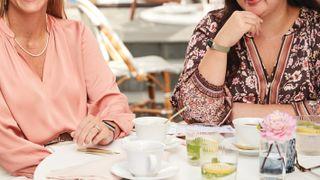 Two women wearing Fitbit Luxe, our best fitness tracker
