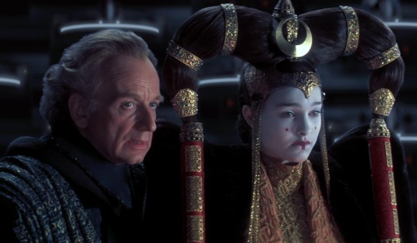 Star Wars: The Phantom Menace Senator Palpatine speaks to Queen Amidala on the senate floor