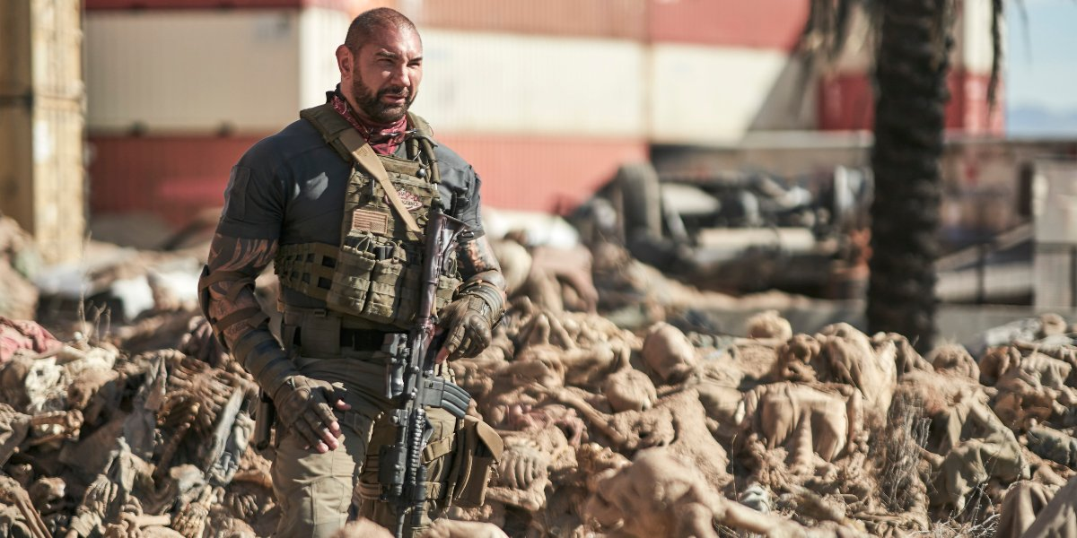 Dave Bautista stands in the middle of dried corpses in Army of the Dead.