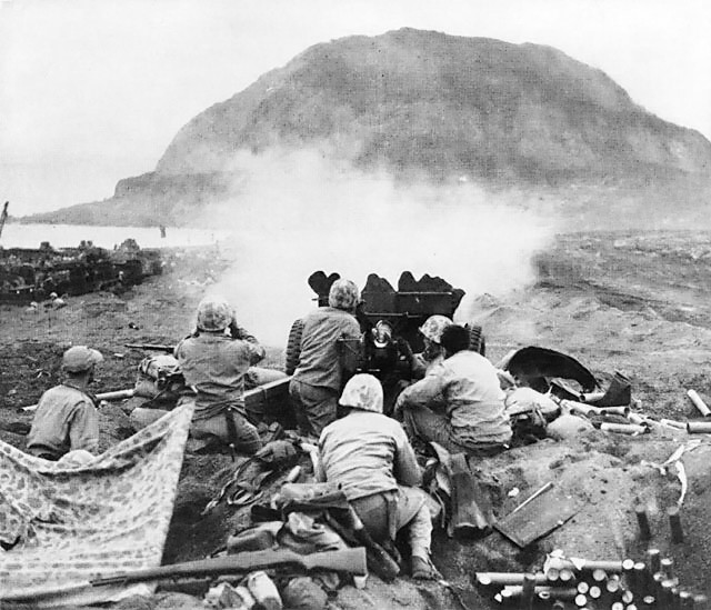 37mm Gun fires against cave positions in north face of volcano in support of RCT 28. These light but extremely accurate weapons did some of their best work in the southern part of the island