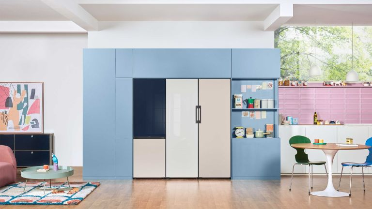 navy, white and blue fridge freezer in a large open plan kitchen living space - samsung