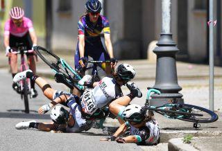 Amanda Spratt, Georgia Williams and Grace Brown of Australia crash on stage 8 of the Giro d'Italia Donne
