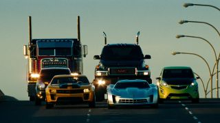 Transformers disguised cars traveling down road