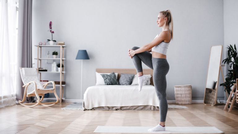 Woman working out in her bedroom