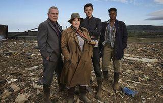 Vera cast stand together