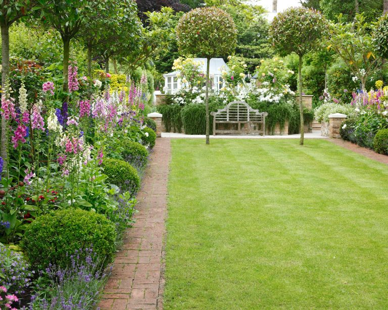 Garden with smart topiary and flower borders
