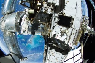 Astronauts Outfitting ISS during spacewalk
