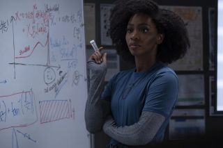 Monica Rambeau at a white board.