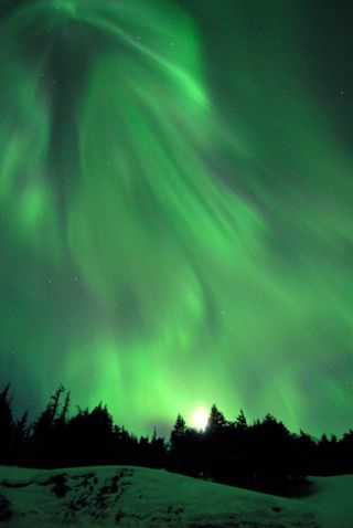 The northern lights hang along the planet's magnetic field. For the first time, scientists have measured the strength of the field in Earth's core.
