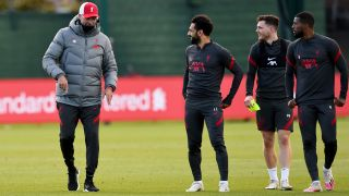 Liverpool FC manager Jurgen Klopp talks with Mohamed Salah during a recent training session at Melwood Training Ground.