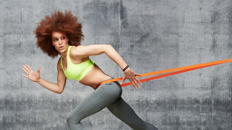 Woman using best resistance bands