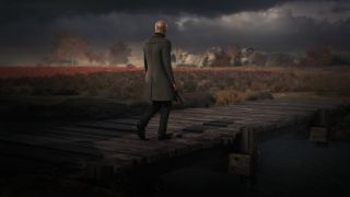 An image from Hitman 3, showing Agent 47 on a pier.