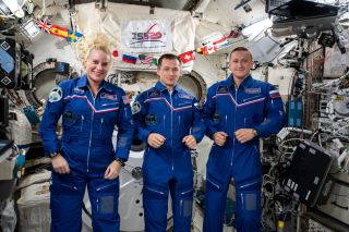 Expedition 64 Flight Engineers Kate Rubins of NASA and Sergey Ryzhikov and Sergey Kud-Sverchkov of Roscosmos, seen here inside the International Space Station's Japanese Kibo laboratory, are scheduled to depart the outpost on April 16, 2021.