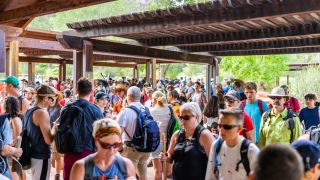 A crowd of people queue to get into Zion National Park in Utah in 2019.