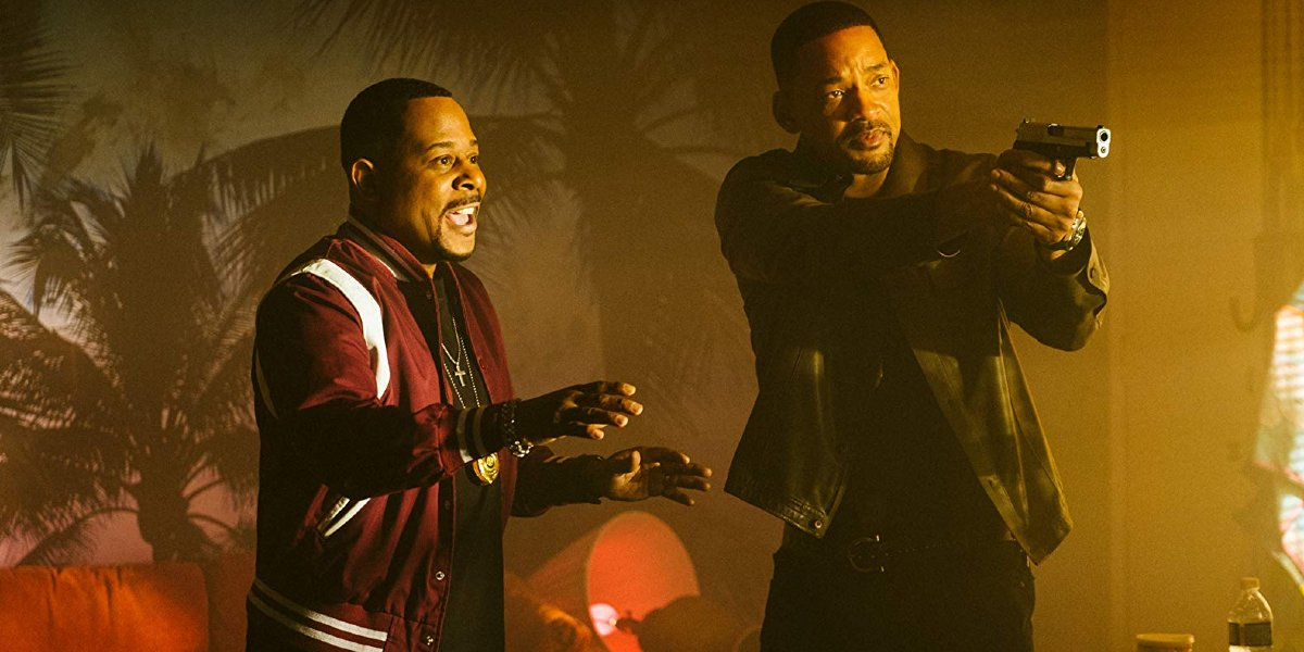 Bad Boys For Life Will Smith aims a gun as Martin Lawrence talks