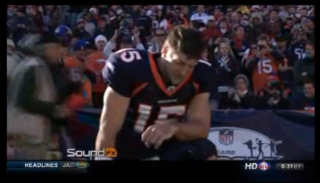 Tim Tebow prays before a Broncos game