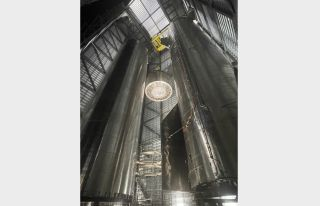 """This photo, tweeted by SpaceX founder and CEO Elon Musk on June 15, shows one of the company's huge Super Heavy booster coming together. """"Stacking Super Heavy aft section,"""" Musk wrote in the tweet."""